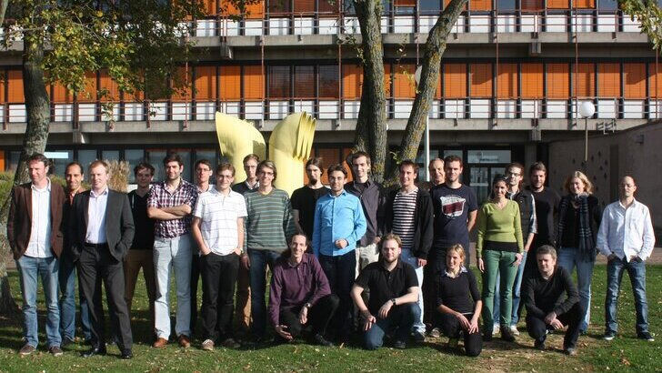 Professors and Staff in front of the physics building